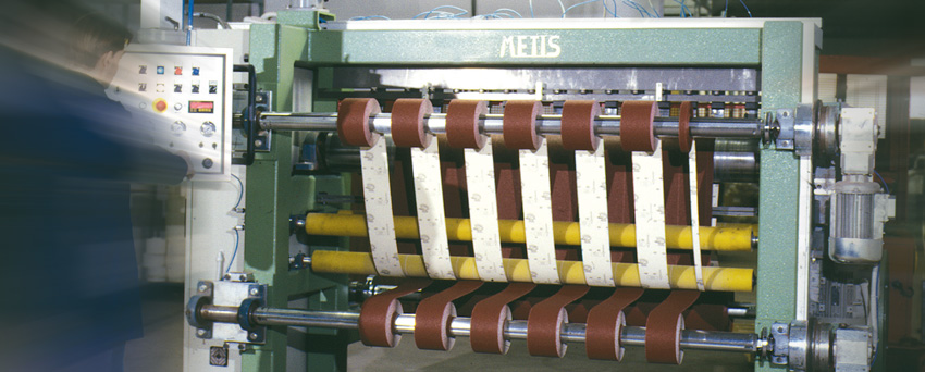 Machine for preparing converted coated flexible abrasive